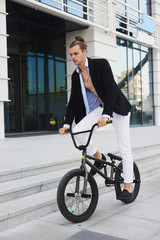 Young Businessman with a bike