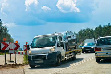 Tow truck with car on road Poland