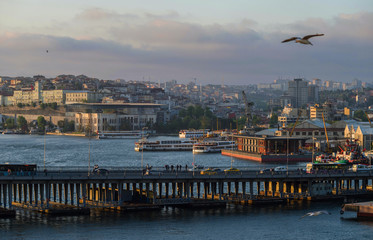 Evening view of the Golden Horn Bay with the Ataturk bridge on the background of a European part of Istanbul.