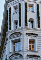 Fragment of Modern apartment building decorated for Christmas in Berlin