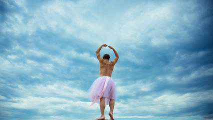 Man in ballerina skirt outdoor. Crazy ballerina. drag queen. Man dancing in tutu in ballet studio. Funny man freak. Inspiration and dreaming. i can be a star. fun party. perfect in every way