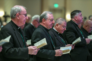 Attendees take part in morning prayers at the U.S. Conference of Catholic Bishops General Assembly in Baltimore