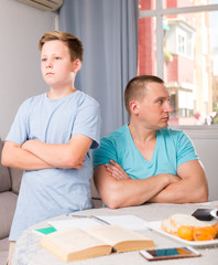 Guy and his father are conflicting in time doing homework