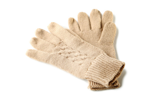 Knitted beige gloves isolated on white background