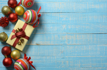gift pack and Christmas decorations on the blue wooden table
