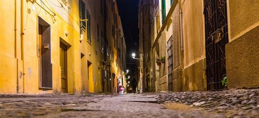 Narrow alley in Alghero by night