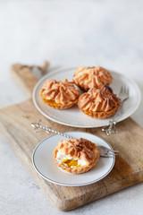 lemon custard tarts with meringue on white background