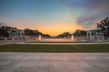 Landmark World War II Memorial fountains at the National Mall in Washington DC seen at sunset. Long Exposure HDR image.