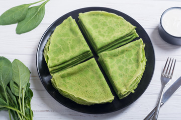 Homemade green pancakes with spinach . healthy crapes