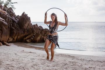 Girl at the beach with hula hoop