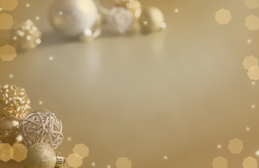 Winter background. Christmas ball golden background. Christmas decoration. Toned effect