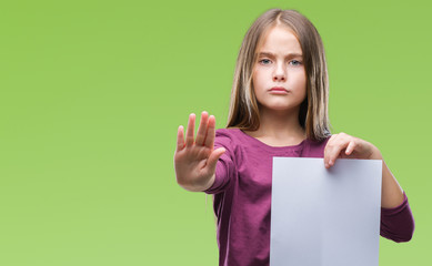 Young beautiful girl holding blank sheet paper over isolated background with open hand doing stop sign with serious and confident expression, defense gesture
