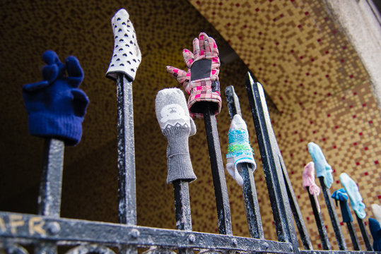 An iron gate serves as a storage area for lost mittens and gloves in Reykjavik, Iceland