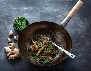 Beef, vegetables and noodles stir-fry in a wok, copy space
