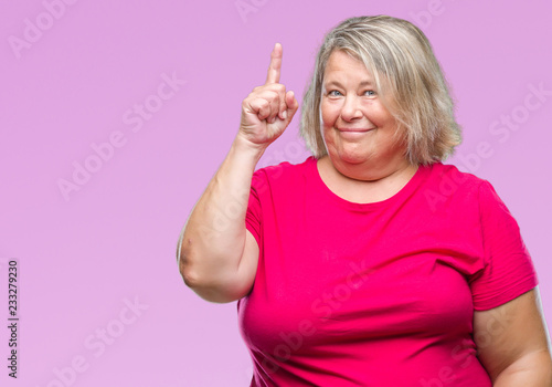 07a7ef5bcb5 Senior plus size caucasian woman over isolated background pointing finger  up with successful idea. Exited