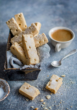 Shortbread with coffee served on table