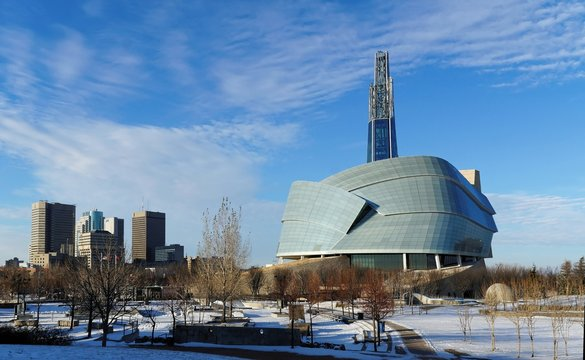 Winnipeg downtown cityscape. Winter view on Canadian Museum for Human Rights seen from The Forks park. Winnipeg, Manitoba, Canada