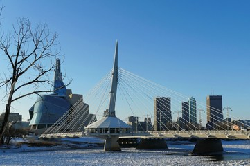 Over the Red River. Winter view on Esplanade Riel bridge with Canadian Museum for Human Rights on the background. Winnipeg, Manitoba, Canada