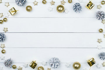White wooden table with golden and white christmas decoration