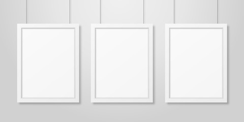 Three Vector Realistic Modern Interior White Blank Vertical A4 Wooden Poster Picture Frame Set Hanging on the Ropes on White Wall Mock-up. Empty Poster Frames Design Template for Mockup, Presentation