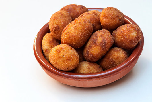 Croquettes surrounded by white background