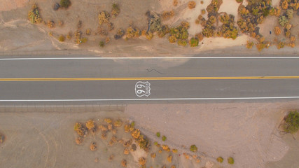 Deurstickers Route 66 AERIAL: Black SUV car on road trip driving along the historic Route 66 in USA