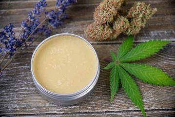 Cannabis hemp cream with marijuana leaf, lavender and nugs