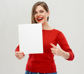 Smiling woman holding white board gesture with finger.
