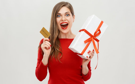 Happy emotional woman holding credit card and gift