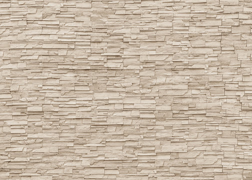 White sepia tan brown rock stone brick tile wall aged texture pattern background
