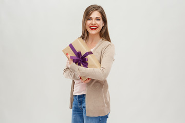 Beautiful woman with long hair standing with gift box.