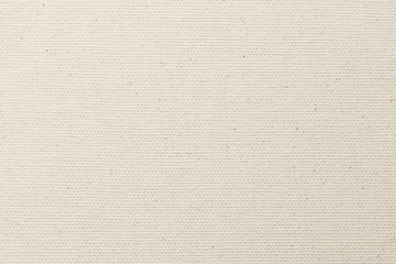 Canvas burlap fabric texture background for arts painting in beige light sepia cream tan brown pastel color