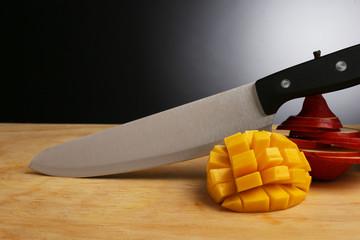 Knife cut mango. Red pear, still life. Minimalist kitchen.