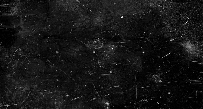 Black scratched grunge background, old film effect, space for text
