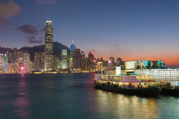 Victoria Harbor of Hong Kong city under sunset