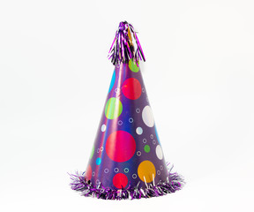 Birthday carton party cone hat with balloons isolated on white background.