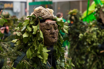 Basel carnival. Barfuesserplatz, Basel, Switzerland - February 21st, 2018. Close-up of a costume made of wood and leaves