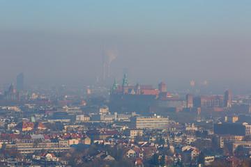 Autocollant pour porte Cracovie Dense smog over the city, aerial view of Krakow, Poland