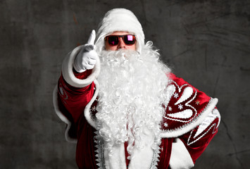 Santa Claus pointing show thumbs up sign for New year, Merry Christmas
