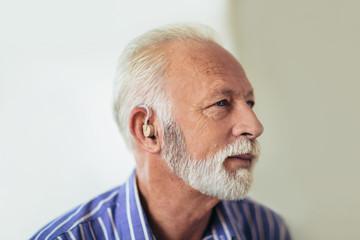 Senior man wearing hearing aid