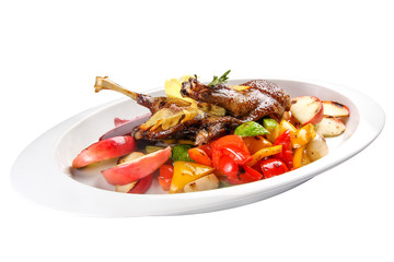 Duck leg with safflowers and grilled vegetables. On a white background