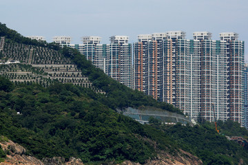 Private residential blocks are seen behind a cemetery in Hong Kong