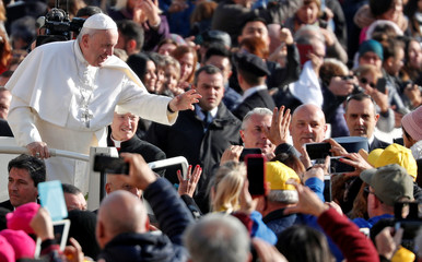 Pope Francis arrives to lead the weekly general audience in Saint Peter's Square at the Vatican