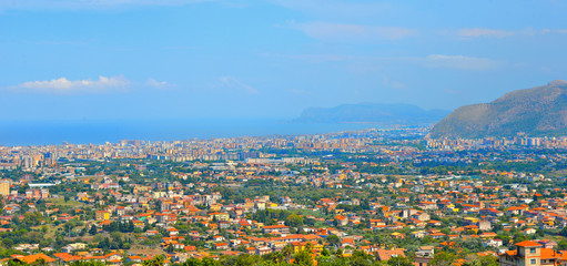 Aerial view and landscape of Palermo and mediterranean sea in background from Monreale. Sicily. Italy.