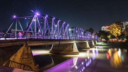 Evening view of the old iron structure bridge in Chiangmai, Thailand.