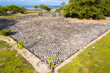 Marae Taputapuatea temple complex. Aerial view. Raiatea island. Leeward / Society Islands, French Polynesia, Oceania, South Pacific Ocean.