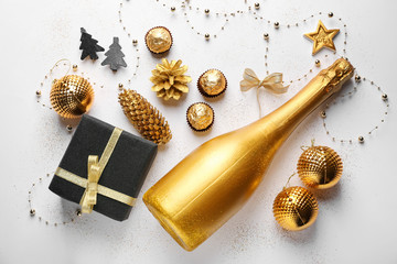 Beautiful composition with champagne and Christmas decor on white background