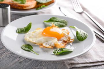 Tasty fried egg on plate