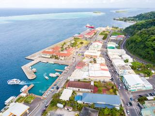 Uturoa, French Polynesia: City centre, port harbour, and ferries to Tahaa. Raiatea, Leeward / Society Islands, Oceania. Aerial photo.