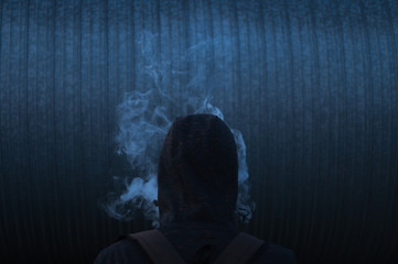 Man in smoke on the dark background